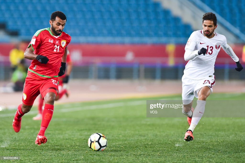 Abdulaziz Al Gheilani #21 of Oman and Sultan Al Brake #13 of Qatar follow the ball during the AFC U-23 Championship Group A match between Oman and Qatar at Changzhou Olympic Sports Center on January 12, 2018 in Changzhou, Jiangsu Province of China.