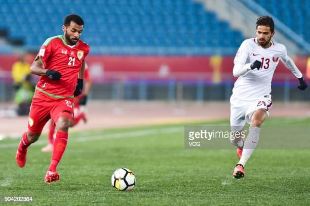 Abdulaziz Al Gheilani of Oman and Sultan Al Brake of Qatar follow the ball during the AFC U23 Championship Group A match between Oman and Qatar at...