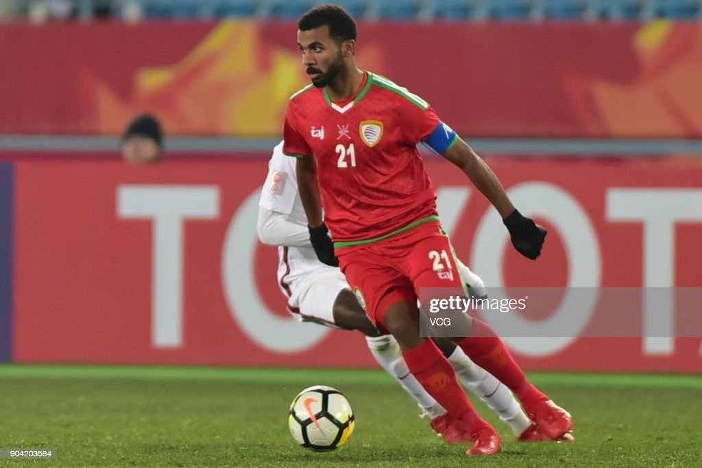 Abdulaziz Al Gheilani #21 of Oman drives the ball during the AFC U-23 Championship Group A match between Oman and Qatar at Changzhou Olympic Sports Center on January 12, 2018 in Changzhou, Jiangsu Province of China.