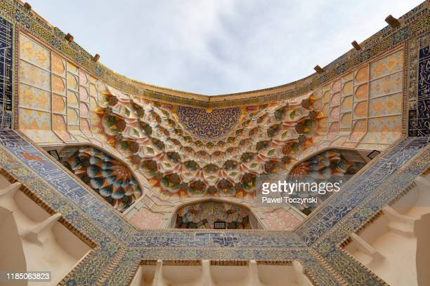 abdulaziz khan madrassah ornate entrance dome, bukhara - trading_post stock pictures, royalty-free photos & images