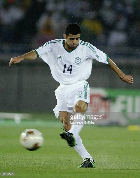 Abdulaziz Khathran of Saudi Arabia has a shot at goal during the FIFA World Cup Finals 2002 Group E match between Republic of Ireland and Saudi...
