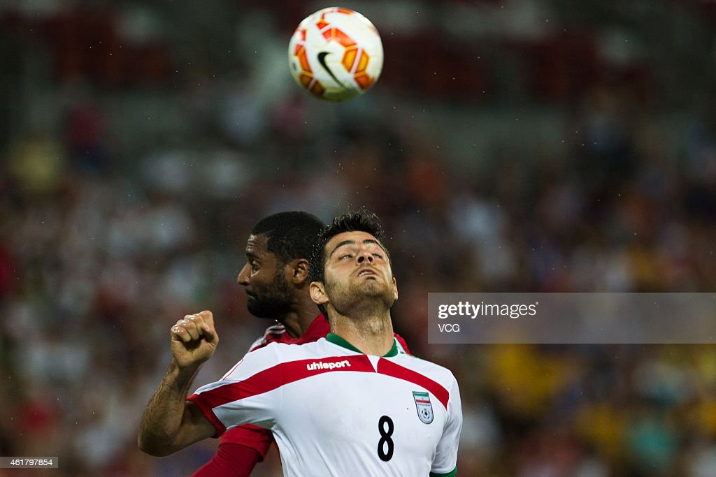 Abdulaziz Sanqour #14 of the United Arab Emirates and Morteza Pouraliganji #8 of Iran compete for the ball during the 2015 Asian Cup match between IR Iran and the UAE at Suncorp Stadium on January 19, 2015 in Brisbane, Australia.