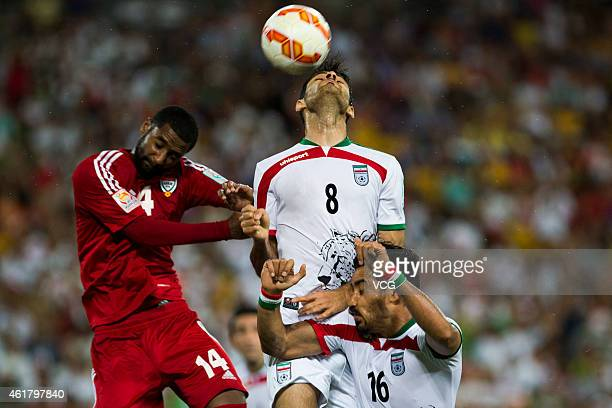 Abdulaziz Sanqour of the United Arab Emirates Morteza Pouraliganji of Iran and Reza Ghoochannejhad of Iran compete for the ball during the 2015 Asian...