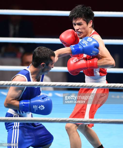 Abdulhaeem Mohibullah of Pakistan competes against Tu Powei of Taiwan during their men's light fly 49kg boxing round of 32 match at the 2018 Asian...
