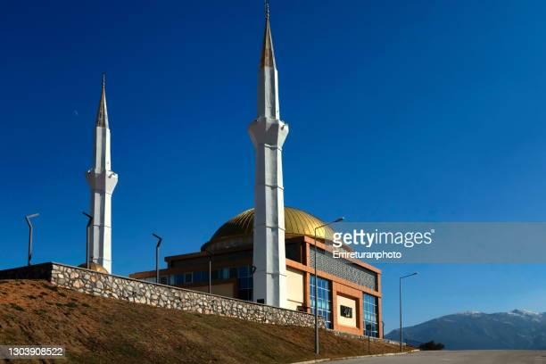 abdulkadir kanat mosque in kemalpasa public park - emreturanphoto stock pictures, royalty-free photos & images