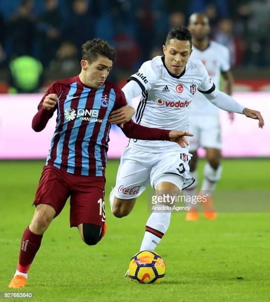 Abdulkadir Omur of Trabzonspor in action against Adriano of Besiktas during the Turkish Super Lig soccer match between Trabzonspor and Besiktas at...