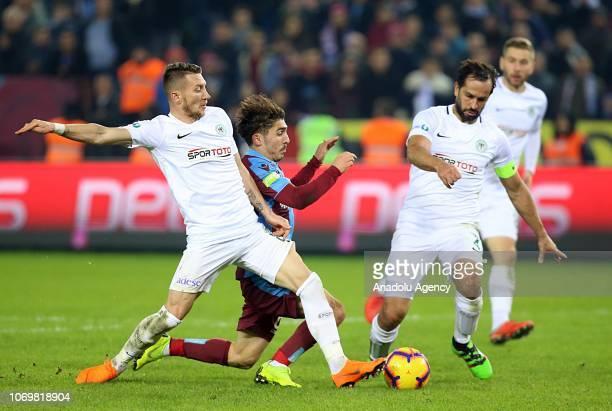 Abdulkadir Omur of Trabzonspor in action against Ferhat Oztorun and Ali Turan of Atiker Konyaspor during Turkish Super Lig soccer match between...