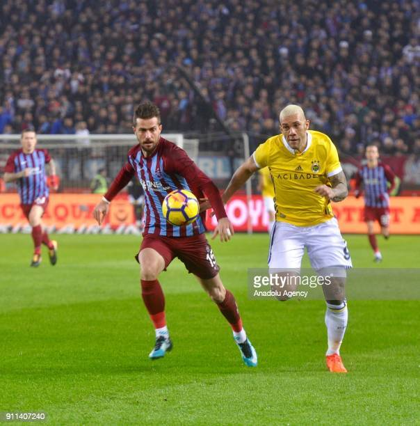Abdulkadir Omur of Trabzonspor in action against Fernandao of Fenerbahce during a Turkish Super Lig match between Trabzonspor and Fenerbahce at...