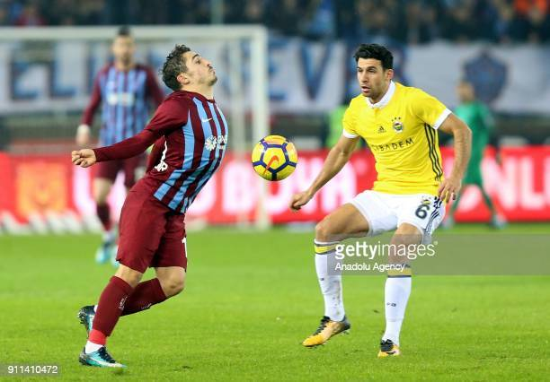 Abdulkadir Omur of Trabzonspor in action against Ismail Koybasi of Fenerbahce during a Turkish Super Lig match between Trabzonspor and Fenerbahce at...