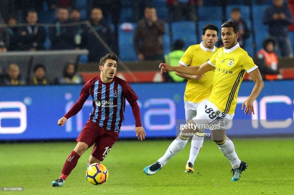 Abdulkadir Omur (L) of Trabzonspor in action against Souza (89) of Fenerbahce during a Turkish Super Lig match between Trabzonspor and Fenerbahce at Medical Park Stadium in Trabzon, Turkey on January 28, 2018.