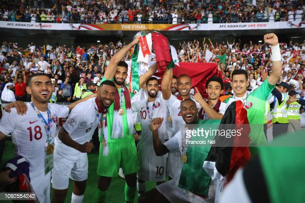 Abdulkarim AlAli Abdelaziz Hatim Saad Al Sheeb Hasan Al Haydos and Abdelkarim Hassan of Qatar celebrates with the AFC Asian Cup Trophy following...