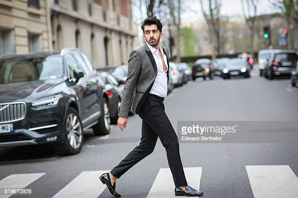 Abdulla Al Abdulla is wearing a The Kooples gray jacket a The Kooples white shirt The Kooples black pants and Saint Laurent black shoes during a...