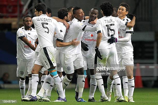 Abdulla Koni of AlSadd celebrates his goal against Esperance Sportive de Tunis with teammates during the FIFA Club World Cup Quarter Final match...