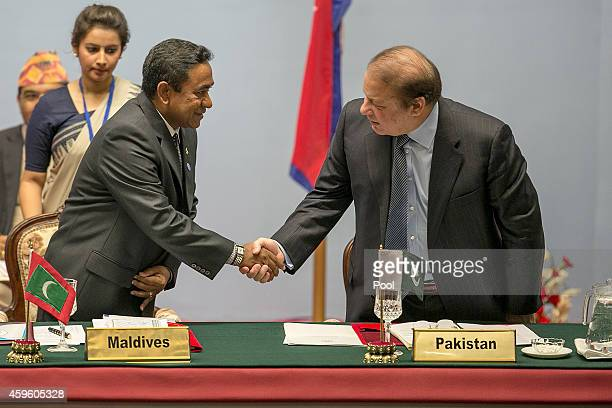 Abdulla Yameen President of the Maldives greets Nawaz Sharif Prime Minister of Pakistan during the inaugural session of the 18th SAARC Summit on...