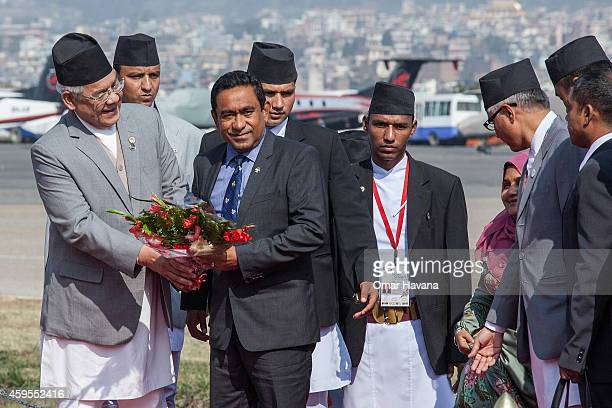 Abdulla Yameen President of the Maldives is greeted by the Deputy Prime Minister of Nepal Bam Dev Gautam as he arrives at Tribhuvan International...