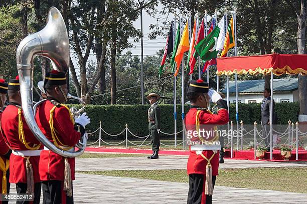 Abdulla Yameen President of the Maldives listens to the National Anthem of his country upon his arrival for the 18th SAARC Summit on November 25 2014...