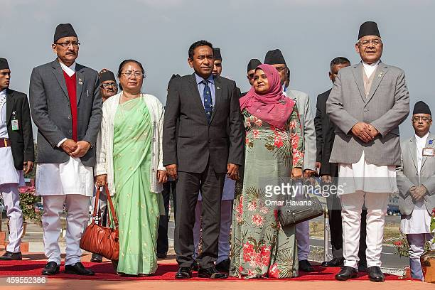 Abdulla Yameen President of the Maldives poses with the Deputy Prime Minister of Nepal Bam Dev Gautam during his arrival for the 18th SAARC Summit on...