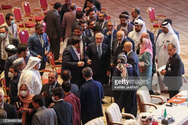 Abdullah Abdullah , Chairman of Afghanistan's High Council for National Reconciliation, speaks with members of delegations at the end of the session...