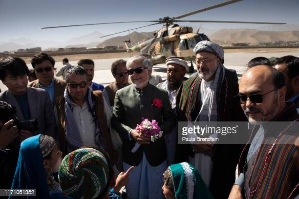 Abdullah Abdullah Chief Executive of Afghanistan arrives via helicopter for the final campaign rally in Bamiyan Afghanistan on September 25 2019...