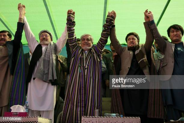 Abdullah Abdullah Chief Executive of Afghanistan holds hands with Ustad Abdul Karim Khalili and Ustad Mohammad Mohaqeq during todays final campaign...