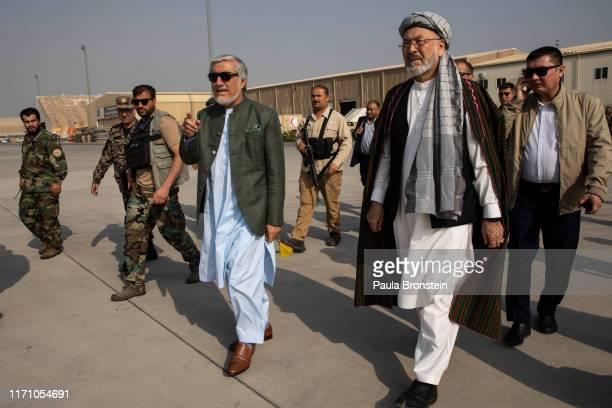 Abdullah Abdullah Chief Executive of Afghanistan walks to the helicopter with Ustad Abdul Karim Khalili heading to todays final campaign rally in...
