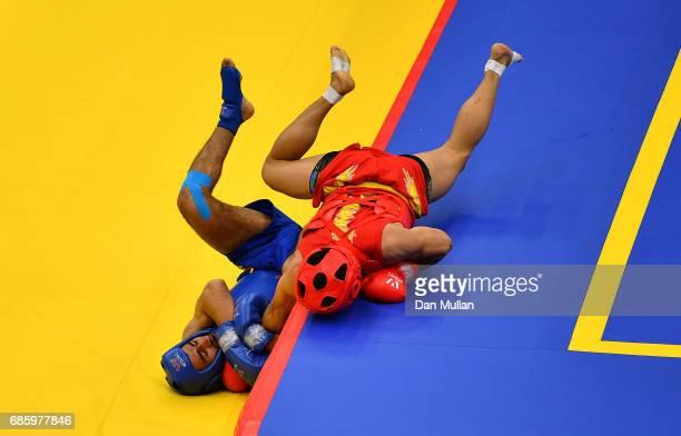 Abdullah Abdullah of Pakistan competes against Ruslan Puraliyev of Azerbaijan in the Mens Wushu 60kg Quarter Final during day nine of Baku 2017 4th...