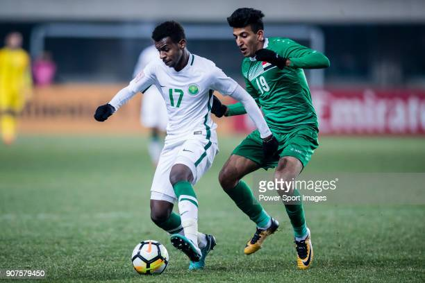 Abdullah Al Khaibari of Saudi Arabia fights for the ball with Amjed Attwan of Iraq during the AFC U23 Championship China 2018 Group C match between...
