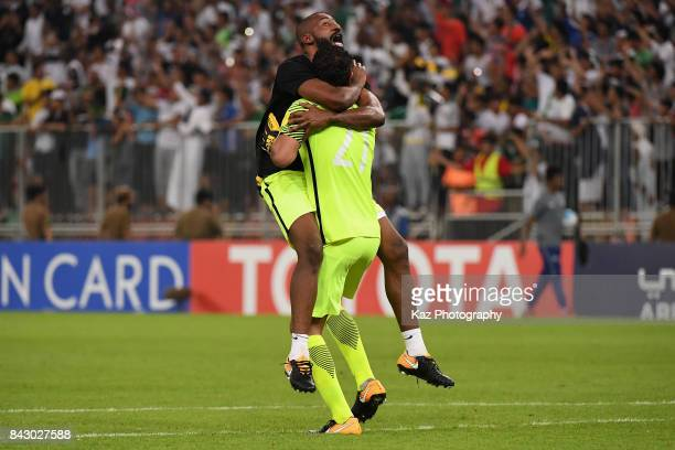 Abdullah Almayouf and Waleed Abdullah of Saudi Arabia celebrate their 10 victory and qualified for the FIFA World Cup Russia after the FIFA World Cup...