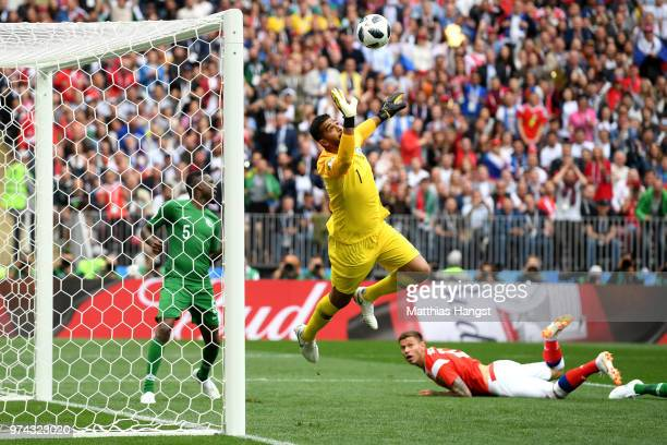 Abdullah Almuaiouf of Saudi Arabia makes a save fromFedor Smolov of Russia during the 2018 FIFA World Cup Russia Group A match between Russia and...