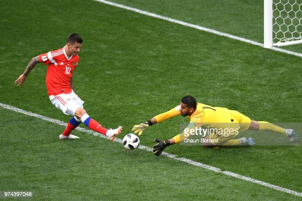 Abdullah Almuaiouf of Saudi Arabia makes a save on Fedor Smolov of Russia during the 2018 FIFA World Cup Russia Group A match between Russia and...