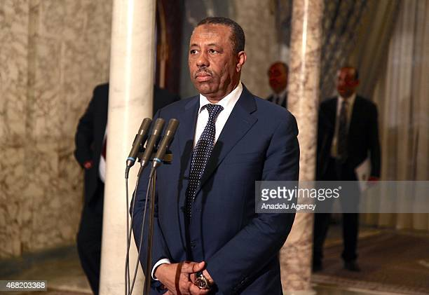 Abdullah alThinni Prime Minister of Libya's Tobrukbased government speaks to the media after holding a meeting with Tunisian President Beji Caid...