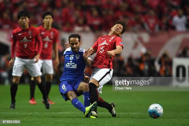 Abdullah Ateef of AlHilal and Kazuki Nagasawa of Urawa Red Diamonds compete for the ball during the AFC Champions League Final second leg match...
