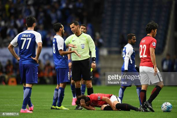 Abdullah Ateef of AlHilal is shown a yellow card by referee Ravshan Irmatov after fouing on Kazuki Nagasawa of Urawa Red Diamonds during the AFC...