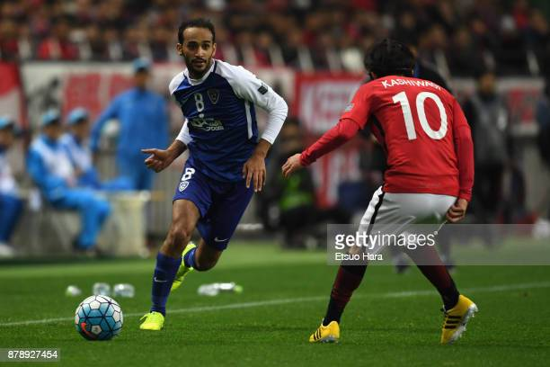 Abdullah Ateef of AlHilal takes on Yosuke Kashiwagi of Urawa Red Diamonds during the AFC Champions League Final second leg match between Urawa Red...