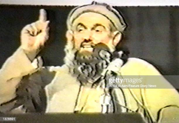 Abdullah Azzam one of Osama bin Laden''s lieutenants speaks in this undated still frame from a recruitment video for bin Landen''s extremist AlQaida...