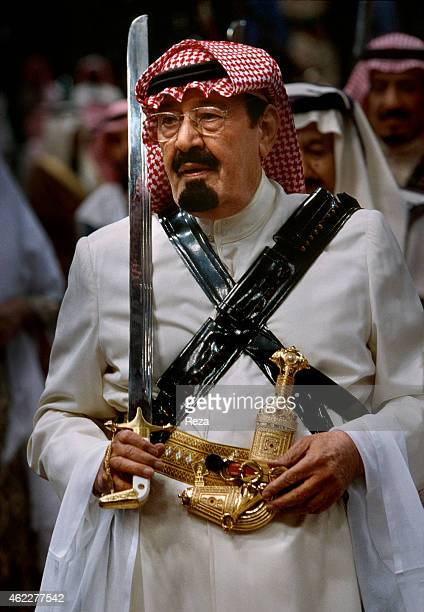 Abdullah bin Abdulaziz Al Saud then prince and later King of Saudi Arabia during the traditional Bedouin sabre dance called Arda