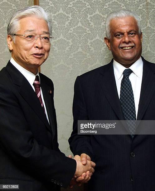 Abdullah bin Hamad alAttiyah Qatar's deputy prime minister and minister of energy and industry right shakes hands with Masayuki Naoshima Japan's...