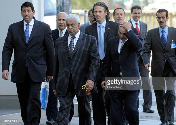 Abdullah bin Hamad alAttiyah Qatar's oil minister center left arrives for the 153rd Organization of Petroleum Exporting Countries meeting in Vienna...
