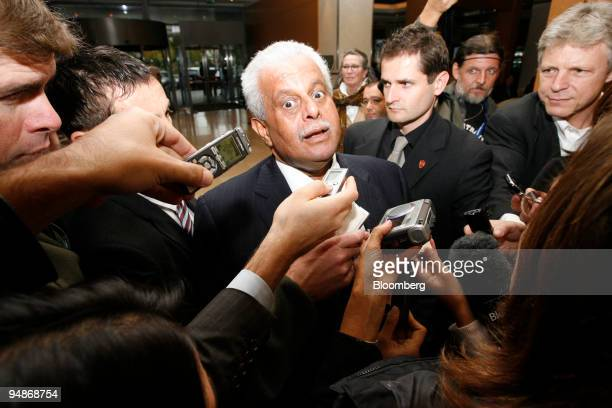 Abdullah bin Hamad alAttiyah Qatar's oil minister center reacts while speaking to journalists as he arrives at his hotel prior to the 150th meeting...