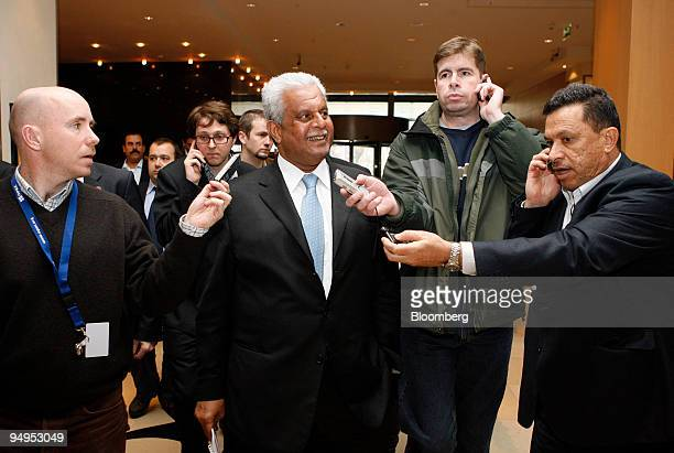 Abdullah bin Hamad alAttiyah Qatar's oil minister center speaks to journalists as he arrives at his hotel prior to an Organization of Petroleum...