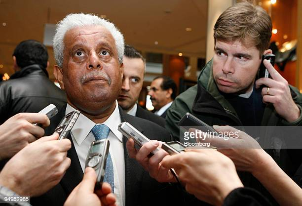 Abdullah bin Hamad alAttiyah Qatar's oil minister left looks up as he speaks to journalists while arriving at his hotel prior to an Organization of...