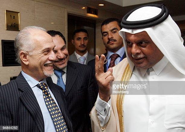 Abdullah bin Hamad alAttiyah Qatar's oil minister right speaks as Hussain alShahristani Iraq's oil minister left listens after a meeting of the...