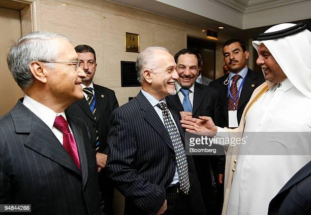 Abdullah bin Hamad alAttiyah Qatar's oil minister right speaks as Hussain alShahristani Iraq's oil minister center and Chakib Khelil Algeria's oil...