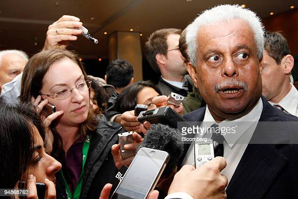 Abdullah bin Hamad alAttiyah Qatar's oil minister right speaks to journalists as he arrives at his hotel prior to the 150th meeting of the...
