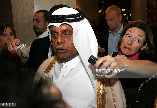 Abdullah bin Hamad alAttiyah Qatar's oil minister speaks to journalists as he arrives at his hotel prior to a meeting of the Organization for...