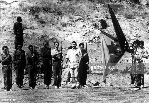 Abdullah Öcalan leader of the PKK is taking the salute of his guerilla fighters in Kurdistan