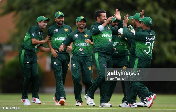 Abdullah Ejaz of Pakistan celebrates with his team mates after taking the wicket of Angus Brown of England during the Physical Disability World...