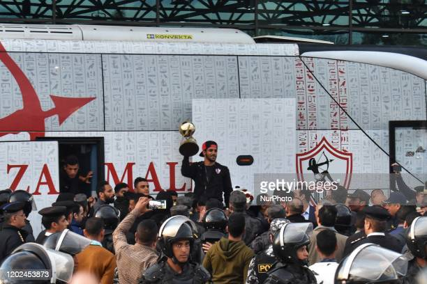 Abdullah gomaa wing left of Zamalek team celebrates with the fans after winning the Egyptian Super Cup at Cairo Airport on February 21