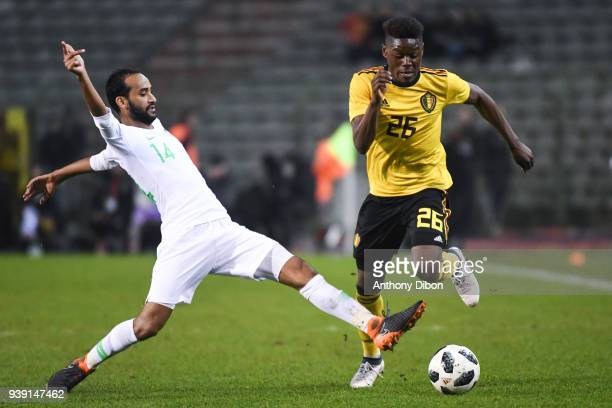 Abdullah Otayf of Saudi Arabia and Anthony Limbombe of Belgium during the International friendly match between Belgium and Saudi Arabia on March 27...