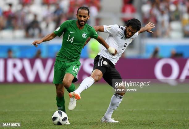 Abdullah Otayf of Saudi Arabia battles for possession with Marwan Mohsen of Egypt during the 2018 FIFA World Cup Russia group A match between Saudia...